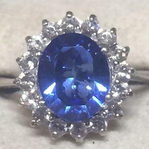 Deep blue topaz with white sapphire halo